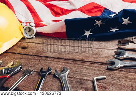 Usa Labor Day Concept, Top View Flat Lay Of Different Kinds Wrenches With American Flag On Wood Tabl