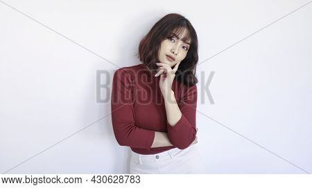 Thinking Gesture Of Asian Beautiful Girl With Red Shirt In White Background