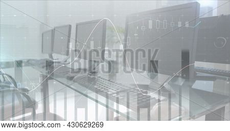 Image of financial data processing with statistics over empty office with computers. global finance and business concept digitally generated image.