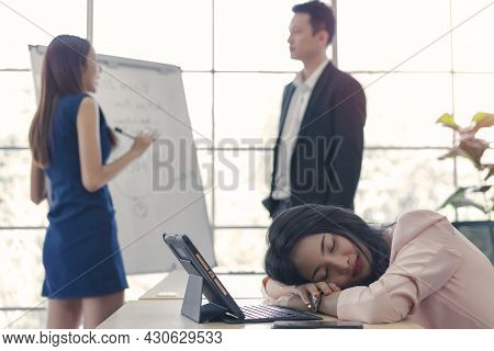 Business Woman Work From Home Sleeping On The Workplace And Feel Tired After Working On Tablet Compu