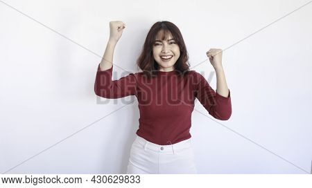 Happy And Winner Asian Beautiful Girl With Red Shirt In White Background