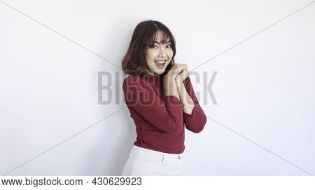 Happy And Excited Asian Beautiful Girl With Red Shirt In White Background