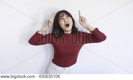 Shock Asian Beautiful Girl Point Above With Red Shirt In White Background