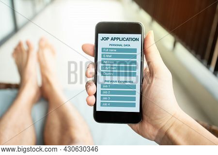Online Job Application With Mobile. Man Filling Up Online Job Application On Phone Screen. Jobless S