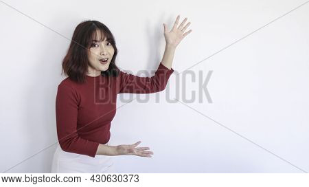 Shock Asian Beautiful Girl Point Beside Her With Red Shirt In White Background