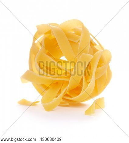 Pasta tagliatelle isolated on white background. Raw fettuccine pasta  italian food at white