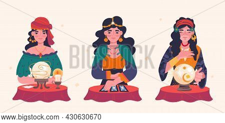 Beautiful Fortune Tellers. Gypsy Oracle. Women Predict Future With Help Of Cards And Magic Sphere. M