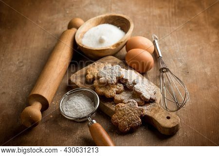 homemade shortbread cookies with rolling pin and ingredients