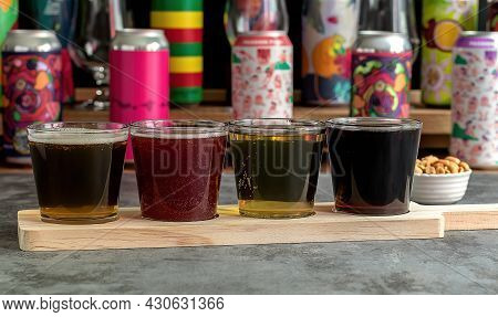 Craft Beer Tasting, Sour Fruit Ipa, Lager, Stout, And Pale Ale. Bar With Different Cans In The Blurr