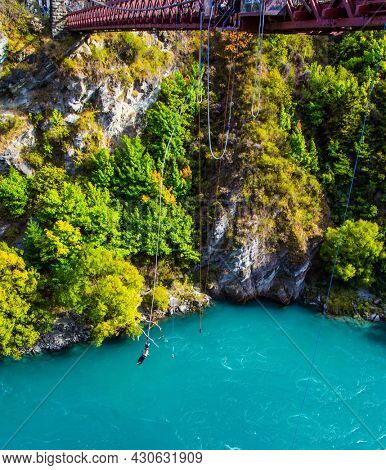 Extreme Sports - bungee jumping into the abyss upside down. New Zealand. River and bridge Kawarau. Incredible Adventures in New Zealand. The concept of extreme, active and photo tourism