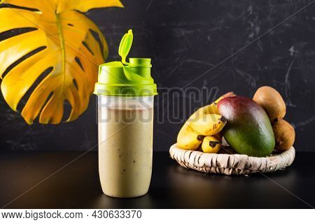 Fresh Protein Drink In A Shaker. Protein Drink With Banana And Fruit. Healthy Food.