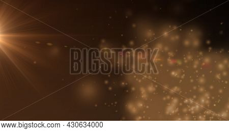Image of orange glowing spotlight over yellow spots in background. Colour and movement concept digitally generated image.