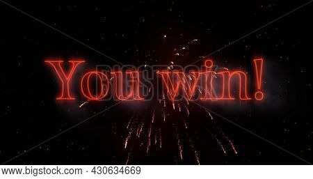 Image of you win text in red glowing letters over explosion of red fireworks. Global network of connection and image game concept digitally generated image.