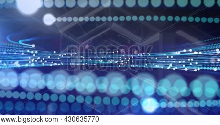 Image of glowing fibre optics turning with futuristic tunnel moving in background. communication technology and global information sharing concept, digitally generated image.