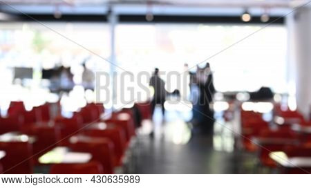 Blurred Abstract Background Of Business People In Conference Or Seminar Room.