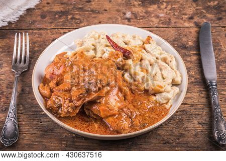 Chicken Paprikash With Gnocchi, Portion Of Stewed Chicken With Hungarian Garnish, Dumplings On A Pla