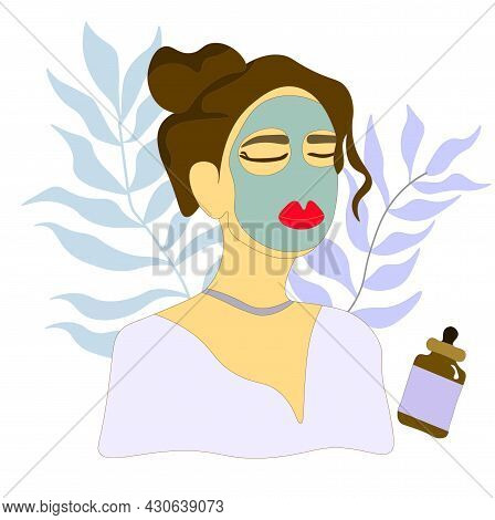 Brunette In A Cosmetic Mask. Beautiful Girl Takes Care Of Her Face And Uses A Face Mask. Woman Doing