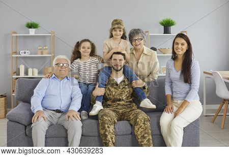 Portrait Of A Happy Military Man At Home With His Big Family. Reunion With Family.