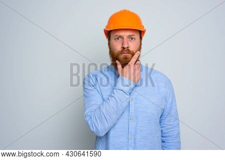 Isolated Doubter Architect With Beard And Orange Helmet