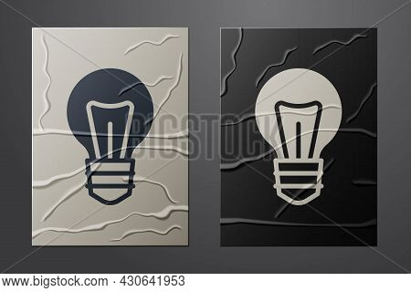 White Light Bulb With Concept Of Idea Icon Isolated On Crumpled Paper Background. Energy And Idea Sy