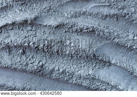 Texture Of Dry Blue Cosmetic Clay With Brushstroke Top View. Abstract Background Of Cambrian Blue Co