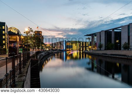 Berlin, Germany - July 29, 2019: Scenic View Of Spree River And Government Buildings Illuminated At