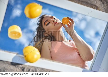 Woman With A Lemon In Her Hands, Beauty Skin Nutrition With Vitamin C. Natural Cosmetics For Facial