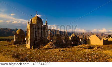 Panorama View To Muslim Cemetery Semiz Bel At Sunset At Kochkor In Naryn Region , Kyrgyzstan