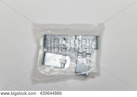 A Set Of Metal Plates In The Package, Parts For Car Repair. A Set Of Spare Parts For Servicing Vehic