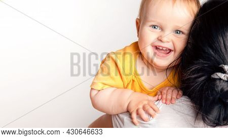 Caring Young Mother Hold Lean To Chest Cute Little Infant Smiling Toddler Back View. Mom Hug Embrace