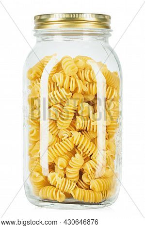 Raw Pasta Fusilli In A Glass Jar  Isolated On White Background. File Contains Clipping Path.
