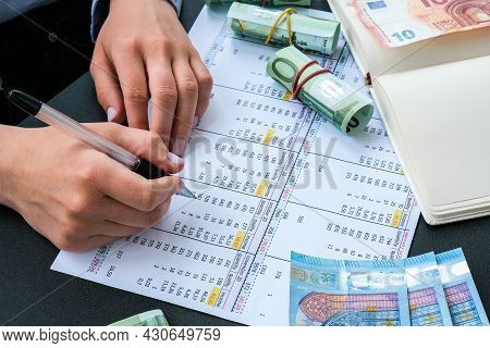 Working Businesswoman Hand At Office Workplace Desk. Counting Money For Salary. Investment Savings.