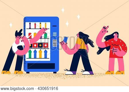Buying Food In Grocery Machine Concept. Group Of Young People Standing Between Grocery Machine Choos