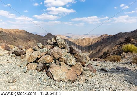 Cairn, Human-made Pile (or Stack) Of Stones, Marking Mountain Top In Hatta, Hajar Mountains, With Dr
