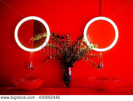 Photo Of Modern Bathroom In Red Tones, Two Round Shapes Stylish Wash Basins, Transparent Vase With B
