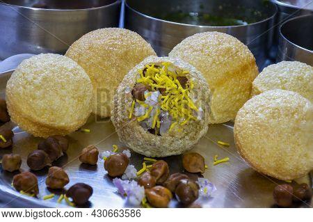 Stock Photo Of Traditional Pupular Indian Street Food Or Snacks Panipuri. Stuffed Puri With Onion Bl
