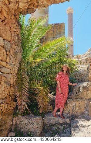 Tourist Among The Archaeological Site Anthony Terms, Ancient Buildings. Ruins Of Antique Carthage Du