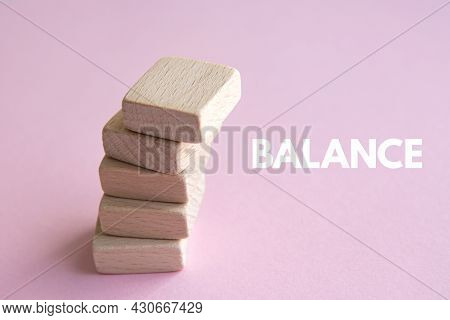 Stack Of Wooden Cubes On Pink Background