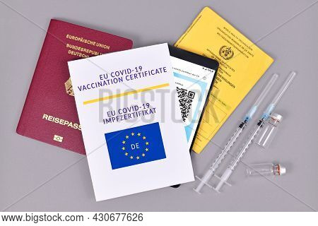 Dossenheim, Germany - July 2021: Eu Covid-19 Vaccination Certificate On Paper And Digital On Phone,