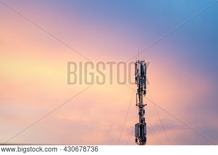 Cell Tower Silhouette Against Orange Sunset Communication Tower Technology Concept Handheld Transmit