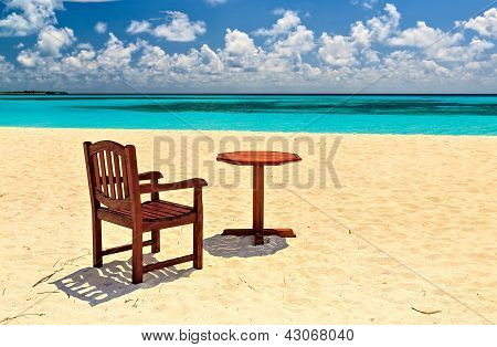 Chairs And  Table Are On The Beach