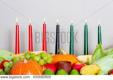 Kwanzaa Afro-american Holiday With Candles On Light Background. Seven Candles As Symbol Of Principle