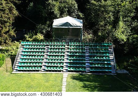Empty Spectator Tribunes Of The Summer Theater In The Park