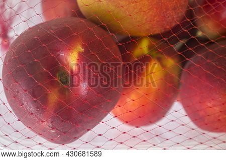 Nectarines On Their Plastic Package Covered. Closeup