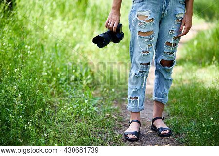 Woman Photographer With A Photo Camera In Hand Outdoor