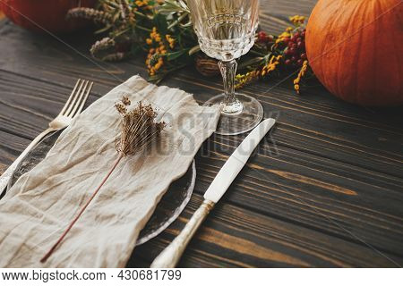 Modern Plate With Vintage Cutlery, Linen Napkin, Herb On Wooden Table With Pumpkins And Autumn Flowe