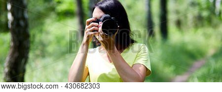 Banner Of Portrait Of A Woman Photographer Covering Her Face With The Camera