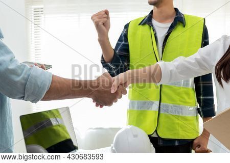 Contractor Team Handshake With Customer After Business Meeting Start Up Project Contract In Construc