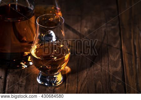 Scotch Whiskey In Special Glasses And Bottle, Old Wooden Background With Negative Space
