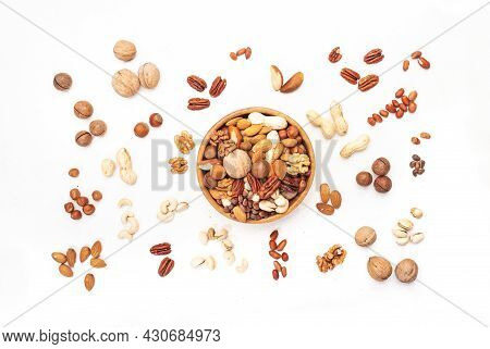 Nut Mix In Bowl. Almonds, Hazelnuts, Walnuts And Other. Healthy Food Snack Mix On White Table, Top V